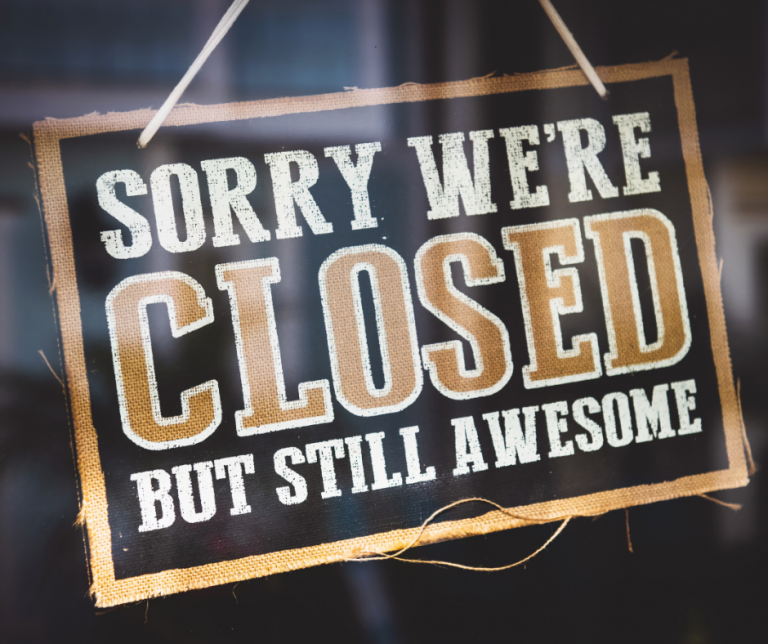 a hanging sign saying sorry we're closed but still awesome